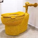 Guerrilla Artist Yarn-Bombs Guggenheim Toilet With Gold Crochet