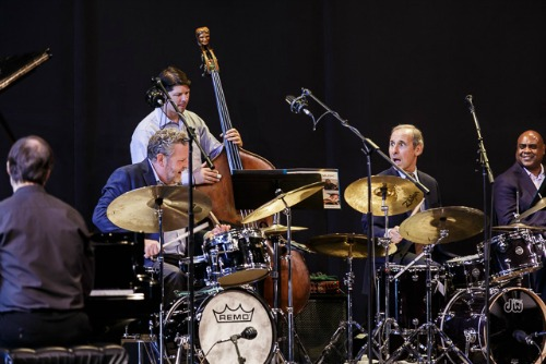 Drummers Jeff Hamilton (L) and Joe LaBarbera (R) lead the Faculty All-Star Big Band Tribute to Woody Herman, at 2016 Jazz Port Townsend. Travis Ranney, tenor; Jay Thomas, tenor; Tracy Knoop, tenor; Gary Smulyan, bari sax; Brad Allison, trumpet; Sean Jones, trumpet; Terell Stafford, trumpet; Thomas Marriott, trumpet; Oliver Groenewald, trumpet; Wycliffe Gordon, trombone; David Marriott, trombone; Greg Schroeder, trombone; John Hansen, piano; Jon Hamar, bass; Jeff Hamilton, drums; Joe LaBarbera, drums
