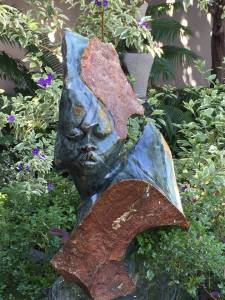 Peter Makuwise 'Shona Queen' (Nyanga Serpentine). One of the 100 stone sculptures on display at the 2016 FACES exhibition at Rwavhi Fine Art gallery in Johannesburg 19 November - 11 December 2016.