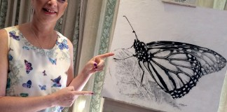 Addi Lang with the butterfly drawing donated to Faces of Hope Foundation
