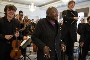 National Youth Orchestra and Patron Archbishop Emeritus Desmond Tutu in Cape Town in July 2016 - Photo by Diana Neille.