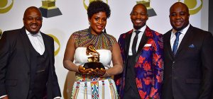 The award was received by album producer Diniloxolo Ndlakuse, Shimmy Jiyane, Mary Mulovhedzi and Mulalo Mulovhedzion on behalf of Soweto Gospel Choir (Photo: Getty)