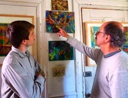 Artist Buck Hastings in the studio with mentor/artist John Riedel.
