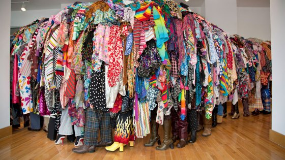 sculpture in form of line of people covered in discarded textiles