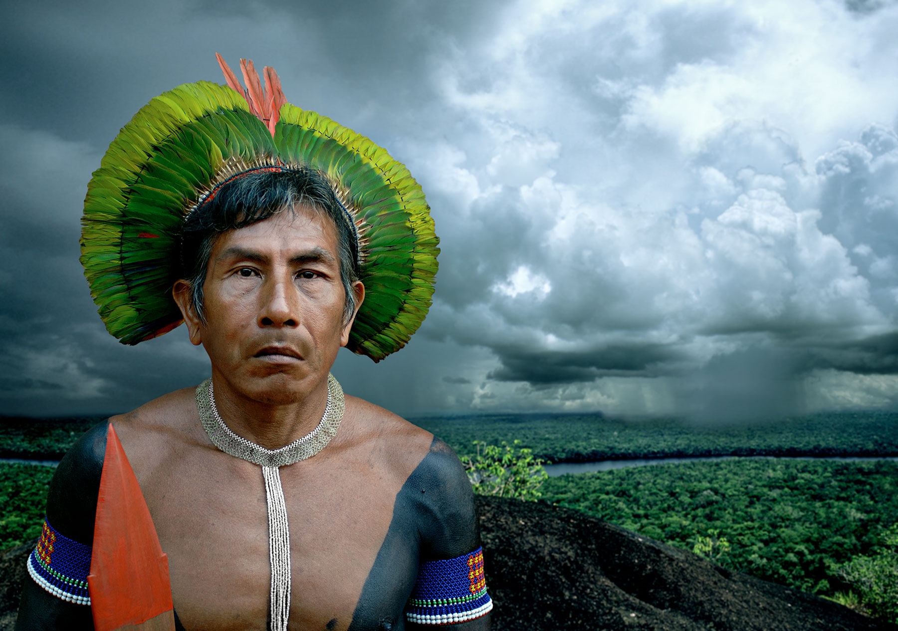 indigenous man in front of natural landscape