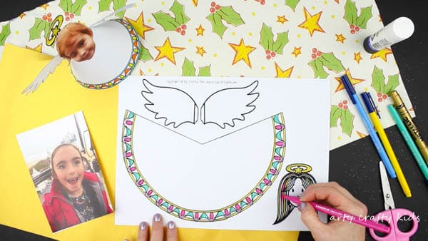 Arty Crafty Kids | Christmas Crafts for Kids | Adorable Paper Angel Christmas Ornamant for Kids, includes a free template for kids to design, colour and cut! #christmascraft #papercraft #christmascraftsforkids #christmasornament #freedownload