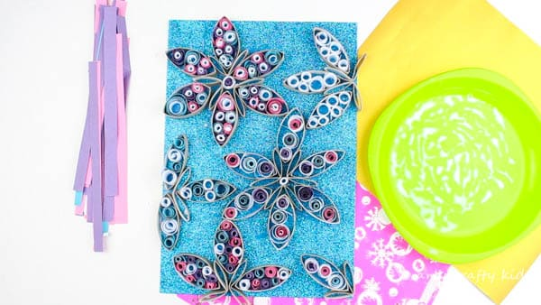 Arty Crafty Kids   Christmas Crafts for Kids   Quilled Paper Tube Snowflake Craft   A beautiful 3D Winter Art Project for Kids using paper tubes and basic quilling techniques to create stunning snowflakes! #snowflakes #christmascrafts #kidsart #christmascraftforkids