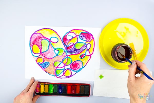 Arty Crafty Kids | Art Ideas for Kids | Yarn Squiggle Heart Art | A fun process art idea for kids, using yarn and watercolour paints to create a cute heart. A simple and fun art project for Valentine's Day! #Valentinesday #artforkids #easyartforkids