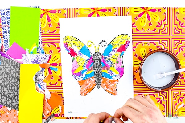 Arty Crafty Kids   Art   Butterly Paper Collage - A simple activity using torn scrap paper to create a colourful, textured butterfly. A wonderful craft for kids! #artycraftykids #recycledcraft #easykidscraft #craftsforkids #kidsart #artideasforkids #easykidsactivities