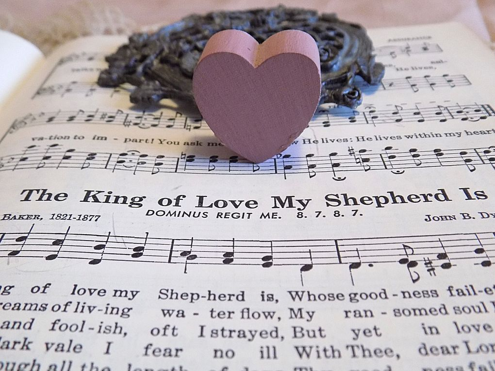 Picture of a mauve heart on a hymnbook open to The King of Love My Shepherd Is