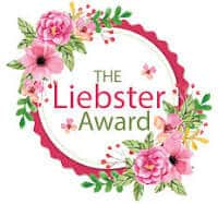 It says the Liebster Award and is surrounded by pink flowers and a pink circle