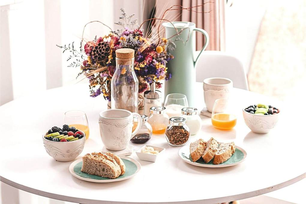 Breakfast table set beautifully juice, fruit, etc.