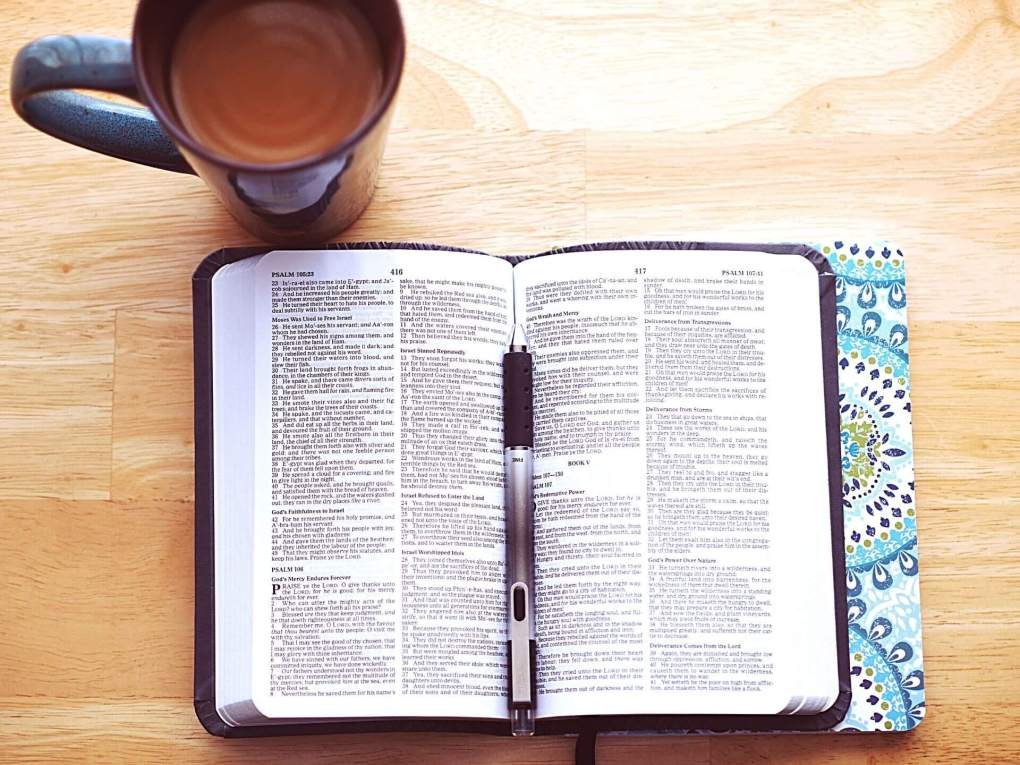 An open bible and a hot drink