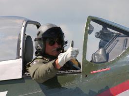 Ret. Brig. Gen. Reg Urchler. miitary general in a small plane.