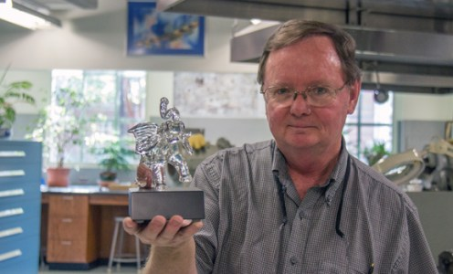 Rick Smith with a glass elephant that he has created