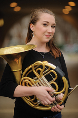 Cynthia Simpson, a graduate student in the School of Music, has played the horn since she was 10 years old. She is one of many UA students who have won or placed in international competitions. Photo Caption: Matthew Wood