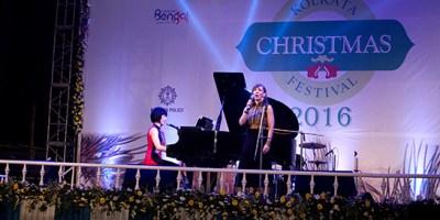Dr. Susan Williams singing at a concert in Kolkata.