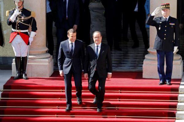 French President Emmanuel Macron and former President Francois Hollande