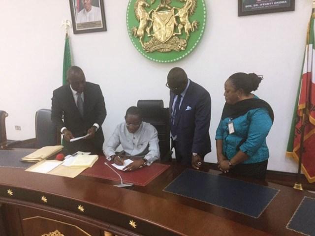 Okowa Signs Bills into Law