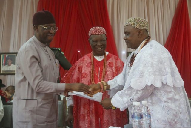 Delta State Governor, Senator Ifeanyi Okowa (left); receiving a letter of address from, His Royal Majesty Emmanuel Efeizomor II, Obi of Owa (middle) and His Royal Majesty, Jonathan Kanegede I, Ogene of Ibedeni, during a Meeting by the Governor on Traditional Rulers, at Owa Oyibu Delta State.