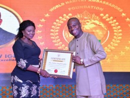Hon Andrew Igban, Receiving an Award of Global Excellence and Certificate of Honours as World Habitat Leadership Conference Ambassador on Youth Empowerment and Community from Mrs Light Diden at Sheraton Hotels and Towers, Abuja