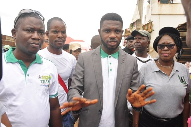 General Manager, Edo State Waste Management Board (EWMB), Mr. Charles Imariagbe (middle); Chairperson, International Federation of Women Lawyers, Edo Chapter (FIDA), Mrs. Edeke Maria Omozele (right); and staff of EWMB, Adams Hafiz (left); during the awareness creation campaign to sensitise Benin City residents on proper waste disposal, in parts of the city on Tuesday, June 26, 2018