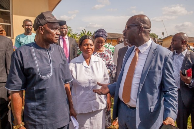 Edo State Governor, Mr. Godwin Obaseki (right); Chairman, Uhunmwode Local Government Council, Hon. Napoleon Agbama (left), during a tour of Uhunmwode Primary Healthcare Center in Ehor, Edo State.