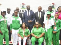 Edo State Governor, Mr. Godwin Obaseki (4th left, back row); Special Adviser to the Governor on Special Duties, Yakubu Gowon (4th right, back row), with coaches and athletes of Edo State origin, who represented the country at the 2018 Commonwealth Games in Australia, after a courtesy visit to the governor, at the Government House, Benin City, on Tuesday, July 17, 2018.