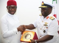 Delta State Governor, Senator Ifeanyi Okowa (left), receiving a plague from the Flag Officer Commanding, Nigerian Navy Logistics Command, Oghara, Rear Admiral Uchenna Onyia, during a courtesy call by the Flag Officer to the Governor in Asaba.