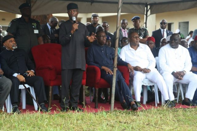 Vice President of the Federal Republic of Nigeria, His Excellency, Prof. Yemi Osinbajo giving his Speech at an IDP Camp, during his visit to Delta State, over the Flooding Incidents in the State