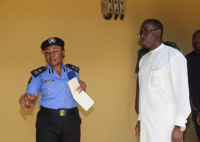 Delta State Governor, Senator Ifeanyi Okowa (right) and Representative of Commissioner of Police; DC II Ngozi Onadeko, during the Official Commissioning of the Nigeria Police Divisional Headquarter Mosogar, Delta State.