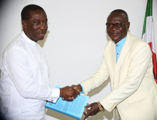 Delta State Governor, Senator Ifeanyi Okowa (left), receiving a copy of address from the new State Chairman of CAN, Snr Apostle Sylvanus Okorote JP during a courtesy call in Asaba.