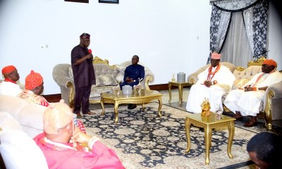 Former President, Chief Olusegun Obasanjo (standing), addressing the Delta State Traditional Rulers Council, while the State Governor, Senator Ifeanyi Okowa (3rd right), during a meeting between the Former President and the State Traditional Rulers Council in Asaba.