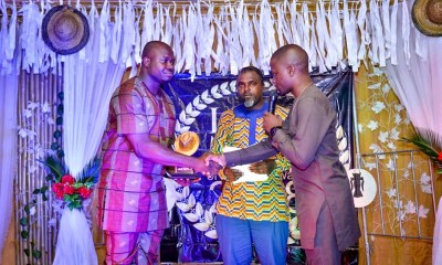 Chairman, Macaulay Media Vanguard, MMV, Mr Iteveh Ekpokpobe, (left) receiving the award on behalf of Comrade Ovuozourie Macaulay.