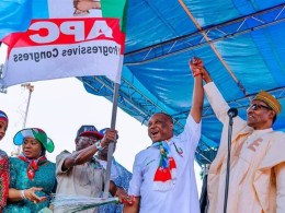 Chief Great Ogboru Receiving the Delta State APC gubernatorial Flag During the APC Presidential Campaign Rally in Warri