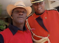 Comrade Sheriff Mulade (left) at a Conference in Kenya