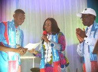 Delta State Governor, Senator Ifeanyi Okowa (right), watching as his wife Dame Edith presents certificate and Cheque to a Gold medalist, Mr Nmor Ifeakachukwu at the Reception/Award of Athletes and Officials to the 4th National Youth Games 2018 and the 19th National Sports Festival, Abuja, in Asaba.