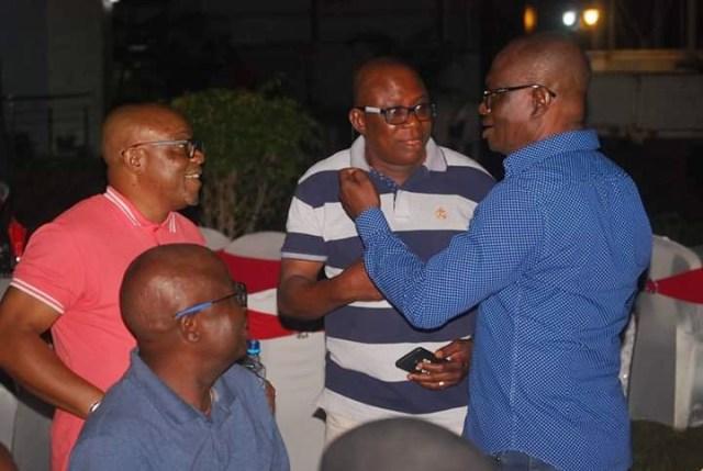 Comrade Ovuozourie Macaulay (right) Celebrates Okowa's Victory with a Party