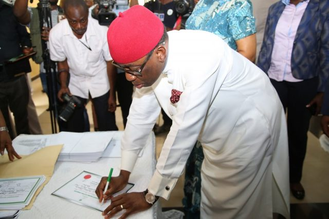 Delta State Governor, Senator Ifeanyi Okowa Signing his Certificate of return, at INEC Delta State Headquarters, Asaba.