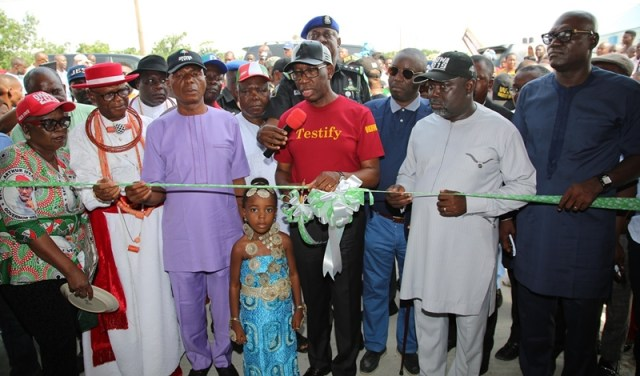 Delta State Governor, Senator Ifeanyi Okowa (4thright); Delta state PDP Chairman, Barr. Kingsley Esiso (right); Senator James Manager (3rdleft); Commissioner for Women Affairs, Rev. Mrs. Omatshola Williams (left); Chief Brown Mene (2ndleft); Chairman, Governing Board DESOPADEC, Hon. Godwin Ebosa (3rdright); Chairman, Warri North Local Government Area, Adoge Okorodudu (2ndright) and Others, during the Commissioning of Concrete Jetty with a Roof/Shore Protection.
