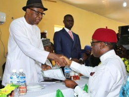 Delta State Governor, Senator Ifeanyi Okowa (right) receiving Governorship Certificate of return from the INEC National Commissioner, Dr. Mohammed Lecky, at INEC Delta State Conference Hall, Asaba.