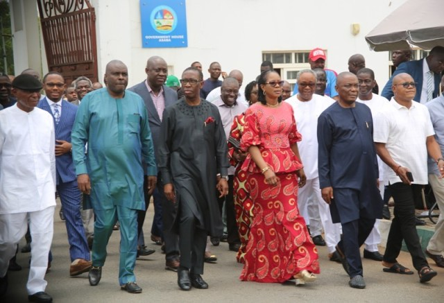 Delta State Governor, Senator Ifeanyi Okowa (3rd left), his wife, Dame Edith (3rd right), former Governor, Chief James Ibori (2nd left), Senator James Manager (left), Senator Peter Nwaoboshi (2nd right), and the DG State PDP campaign organization Rt Hon Funkekeme Solomon (right), moving to the Government House Chapel for a victory thanksgiving shortly after being declared the winner of the just concluded State Governorship election in Asaba.
