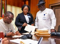 Delta State Governor, Senator Ifeanyi Okowa (left); Speaker, Delta State House of Assembly, Rt. Hon. Sheriff Oborevwori (right) and Clerk of the House, Barr. (Mrs.) Lyna Ocholor, during the Signing into law of 6 Bills Passed by the State House of Assembly on May 16, 2019