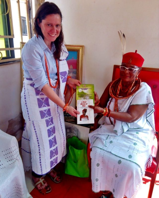 Omu Anioma presenting books on Omu institution to the Leader of the EU Team