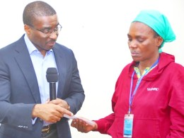 The Chief of Staff Government House, Olorogun David Edevbie, (left), presenting a cheque to the Mrs Elizabeth Ogege, mother late Miss Elozino Ogege in Asaba.