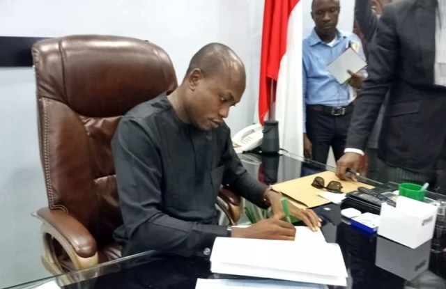 Dr. Michael Tidi, Chairman of Warri South Local Government Area Signing the Delta-Ukpokiti Industrial City MOU