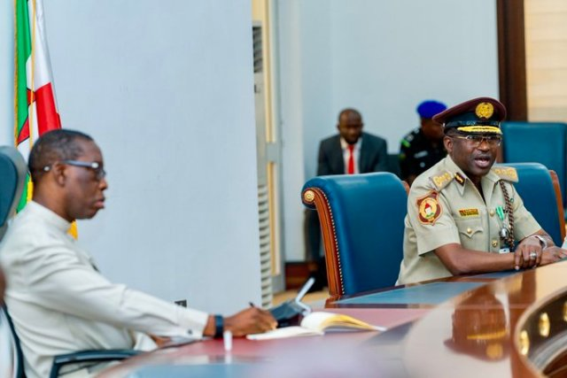 Delta State Governor, Senator Ifeanyi Okowa (left) and the Comptroller General of the Nigeria Immigration Service, Mohammad Babandede, during a courtesy call on the Governor, by the Comptroller General at Government House Asaba.