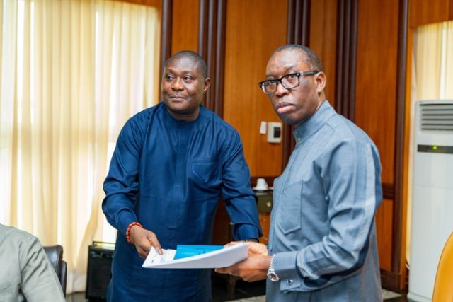 Delta State Governor, Senator Ifeanyi Okowa (right) receiving the Final Report of the Measure Requiredto tackle and control Flooding in Effurun/Warri and its Environs from the Commissioner for Works, Chief James Augoye, during a presentation to the Governor, in Government House Asaba.