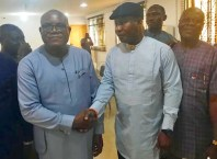 L-R: Chief Solomon Funkekeme, Senior Political Adviser to Governor Okowa and Chief Julius Takeme, Chairman, Delta South PDP in a Handshake