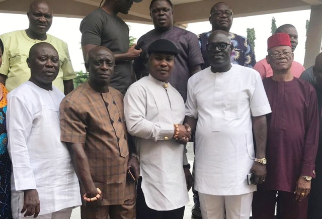 Delta State PDP Chairman, Olorogun Kingsley Esiso (2nd right) in a Handshake with Chief Julius Takeme at the PDP State Secretariat Asaba..